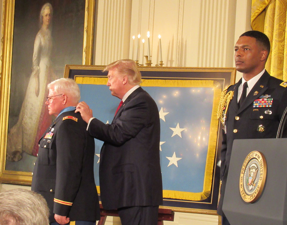 President Trump about to present the Medal of Honor to Captain Gary M. Rose, USA (ret), in the White House East Room. Mike was a 22-year old sergeant in 1970, when he earned the Medal. (Photo by Gail Plaster)
